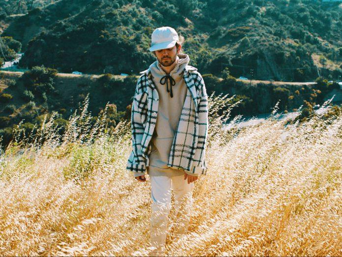 Madeon walking through field